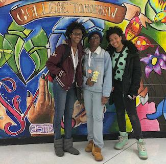 Students in front of mural.