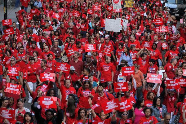 Photo of teachers striking.