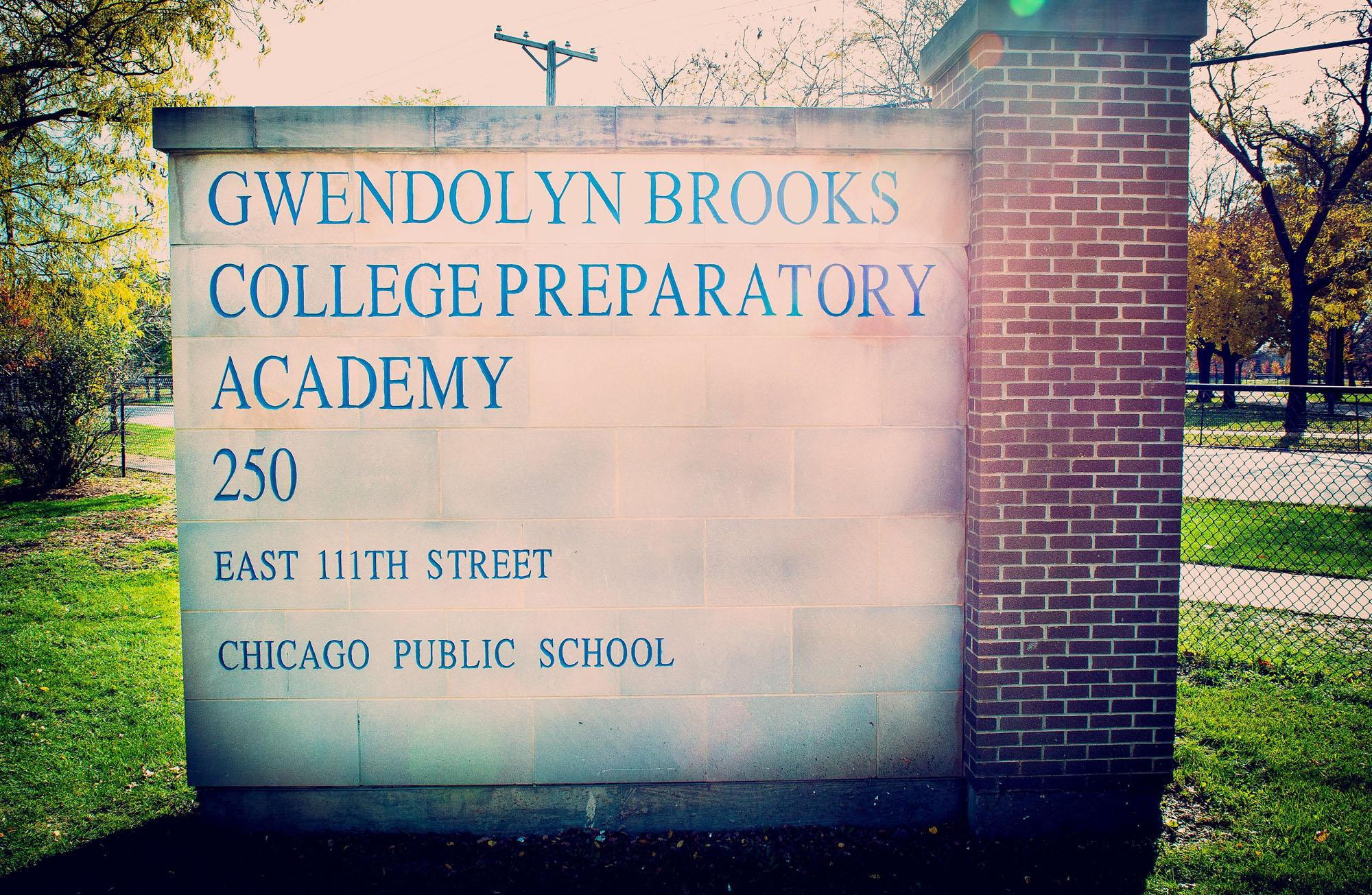 Photo of brick and stone school sign on 111th.