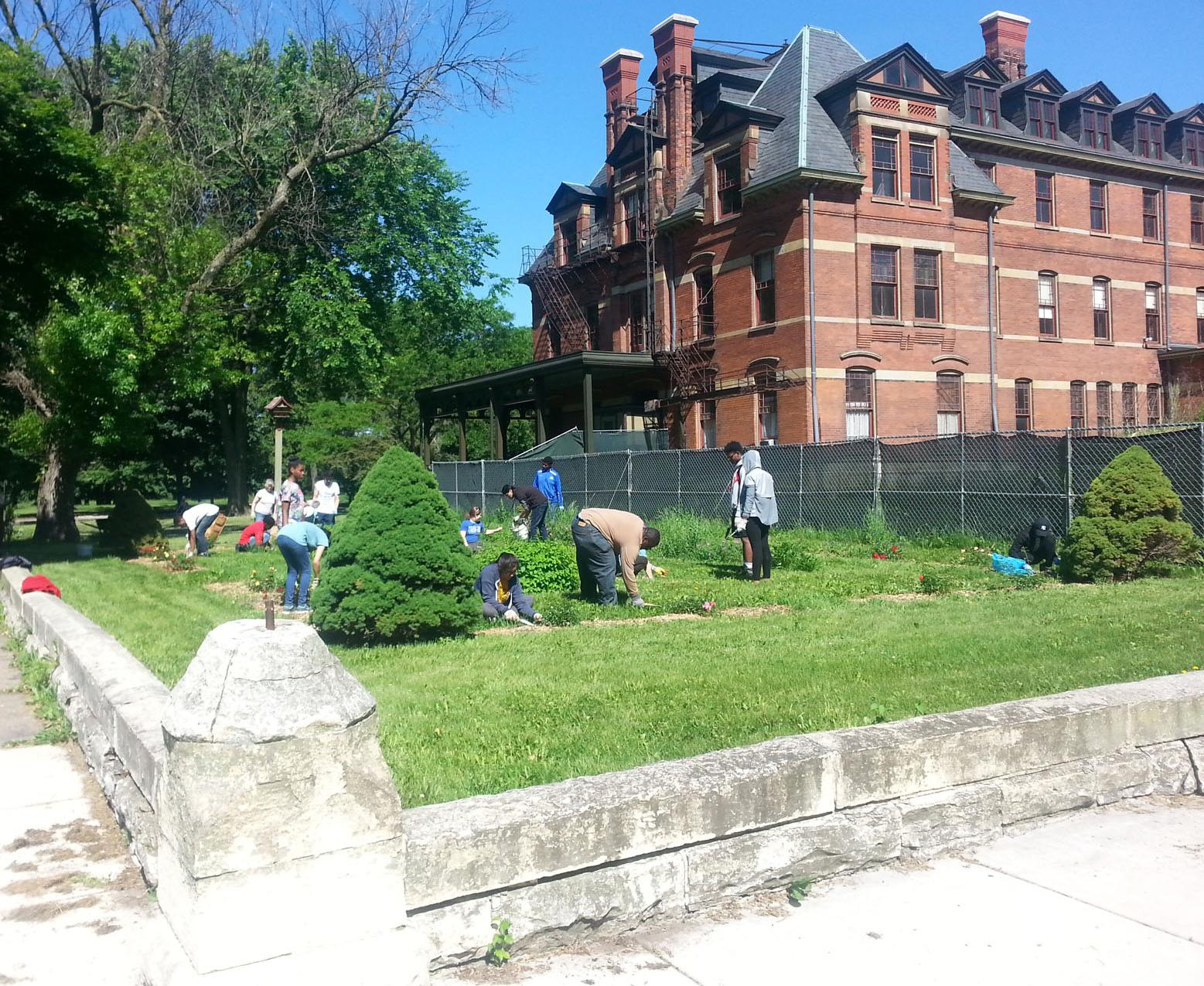 Brooks students weeding the gardens of the Florence Hotel, a part of the Pullman National Historic Park.
