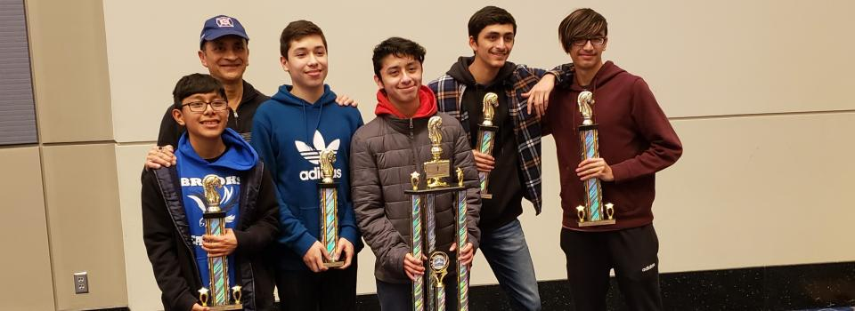 Brooks High School Chess Team and their trophies.