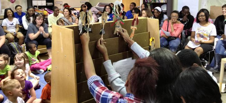 Photos of students running puppet show in front of preschoolers.