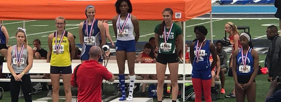 Imani Carothers on first place podium.