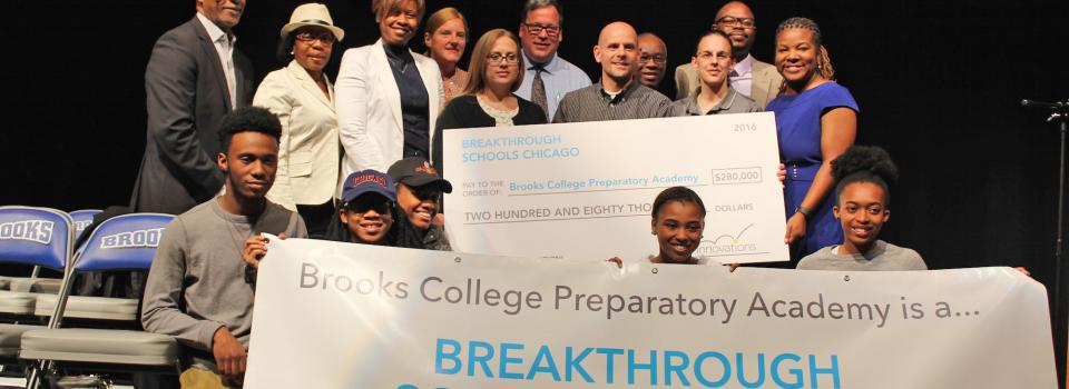 Photo of staff, students and LSC members with check.