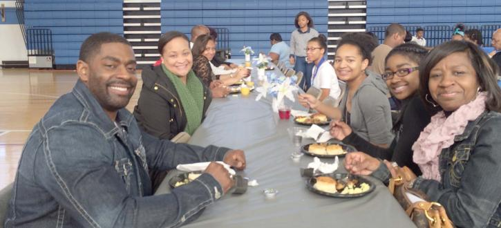 Photo of parenst and students at the Honors Breakfast 2014
