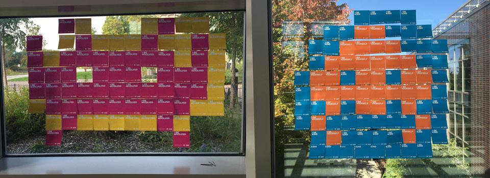 Two of the post it note space invaders created by students.