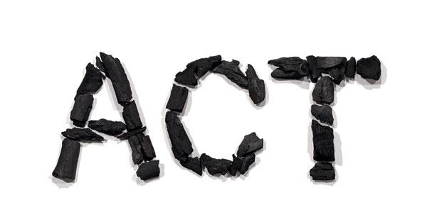 Image of the letters A C T created with pieces of coal.