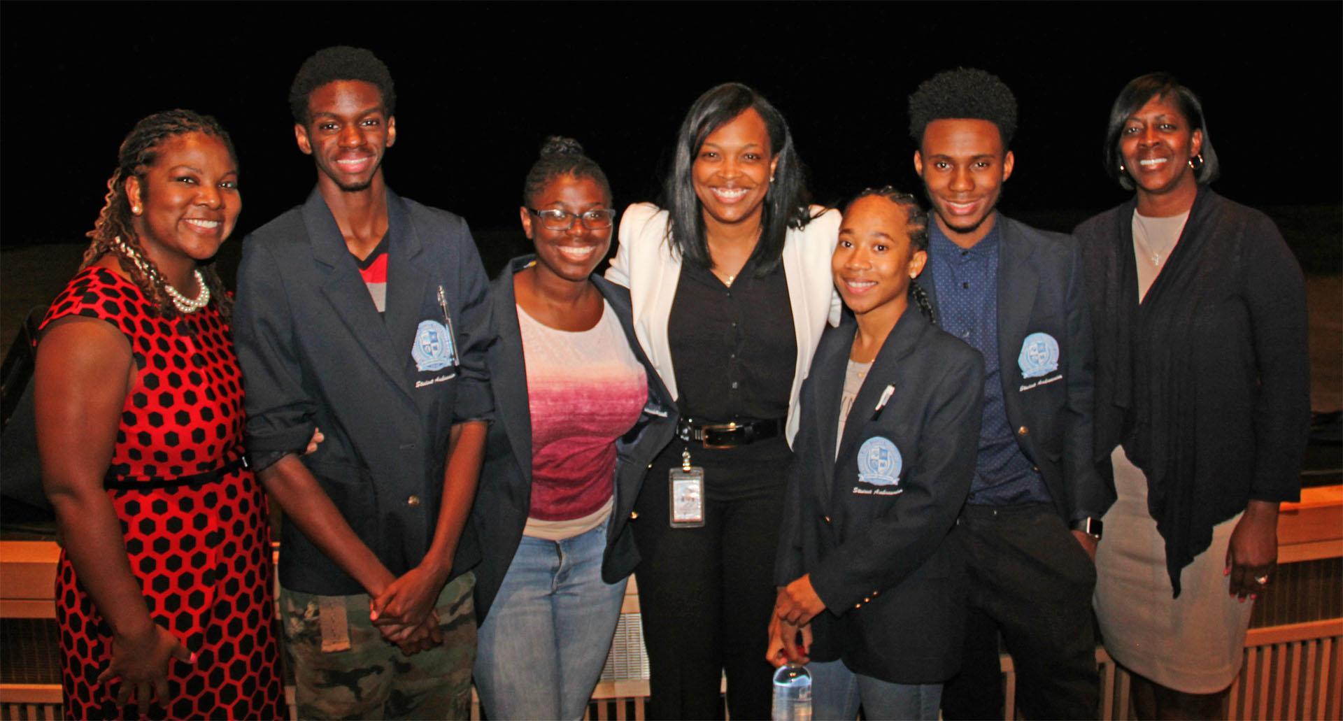 Photo of Principal Jackson, students and Dr. Jackson.
