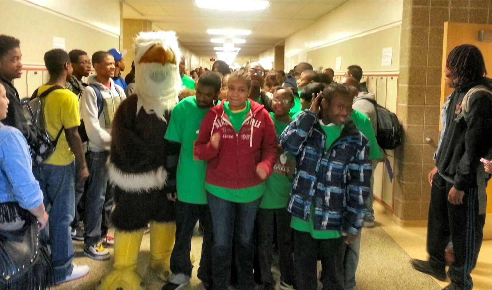 Photo of students going through pep rally with Eddie the Eagle.