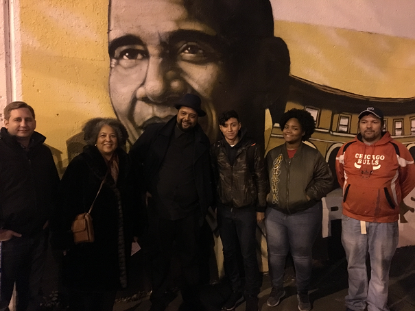Mr. Mitchell, with the artist Rahmaan Statik and student volunteers in front of mural about Pullman.