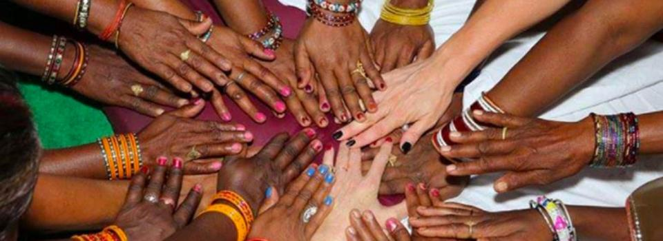 Hands of people of different races.